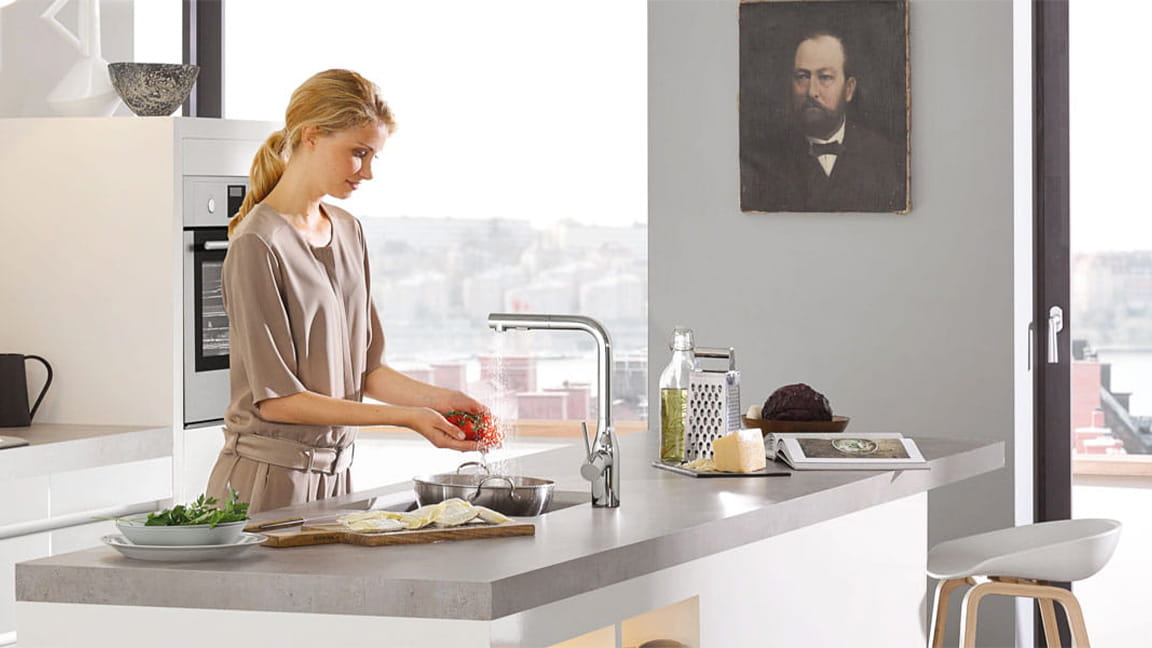 Essence Kitchen Faucet with woman washing produce